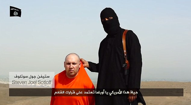 Horror: In another chilling warning, the executioner holds another man, on his knees with his hands tied behind his back, by the scruff of the neck. A caption claims it is missing American Steven Joel Soltoff